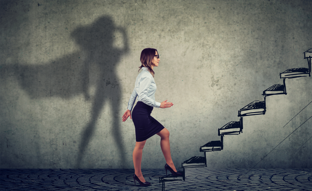 Women walking up stairs with silhouette superwomen